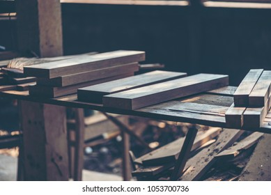 Background image of woodworking workshop: carpenters work table with different tools and wood cutting stand, vintage filter image