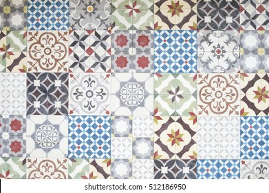 Background of jumble of mismatched tiles with vintage decorative patterns