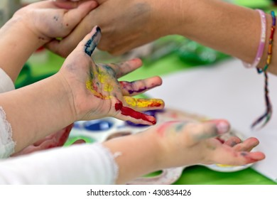 Background with kids painted hands. Happy childhood.