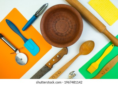 Background of kitchen utensils on white wooden kitchen table. tools. Top view