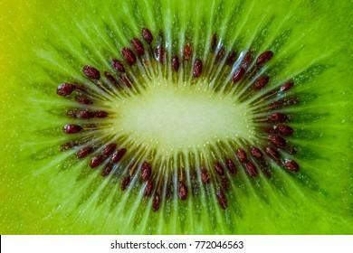 Background with kiwi macro. Texture of kiwi macro. Slice of kiwi macro.