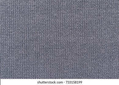 background of knitted texture of fabric of pale color or knitwear closeup