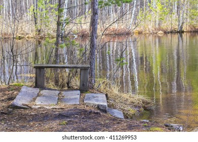 background landscape beautiful view of the lake in the protected pine forest, with stone steps and wooden bench