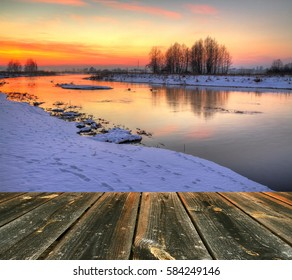 Background Landscape - sundown or sunset in Suprasl river valley. Winter time in Knyszynska Forest, North - Eastern part of Poland, Europe. Wooden floor added.