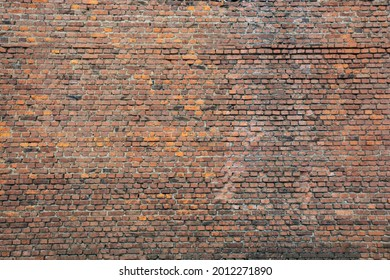 background large old weathered red brick wall with cracks