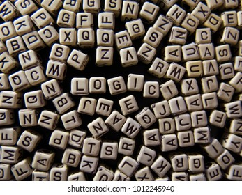 Background from letters with the word LOGIC on a dark background