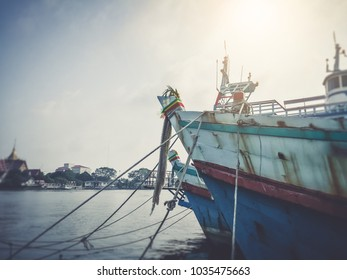 Background of local fisherman boat in asia waiting to go out harvest seafood animal like fish, shrimp and crab.