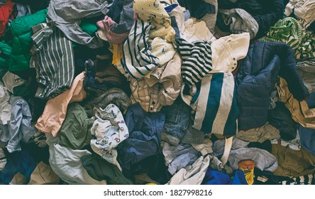 The background from the lots of kids clothes lying on the floor