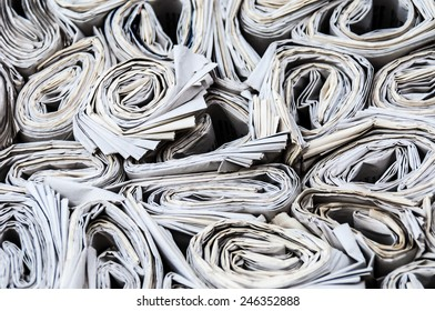 background of lots of rolls of newspapers