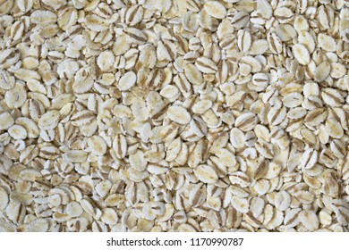 Background made of barley flakes. Grained texture. Top view