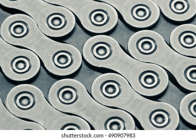 Background made of bicycle chain, macro shot, diagonal