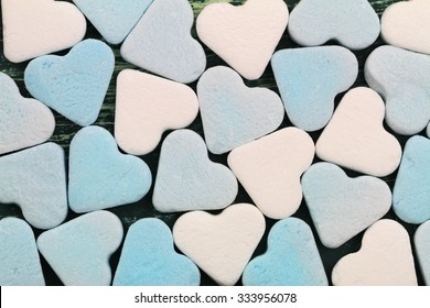 Background made of blue and white sugar hearts
