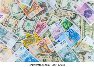 Background made of dollar, euro and polish zloty banknotes