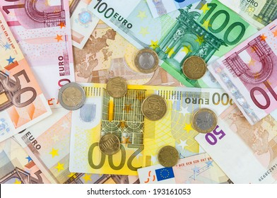 Background made of euro banknotes and coins