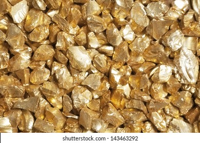 Background made of golden nuggets, symbol of safe investment.