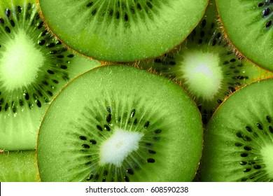 background made with a heap of sliced kiwi