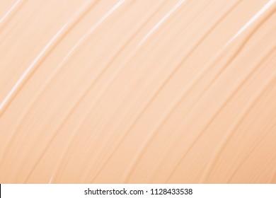 Background made of liquid foundation. Make-up concept
