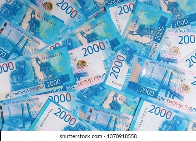 Background made of new russian money banknotes of two thousand roubles. Success in business, finance, wealth concept