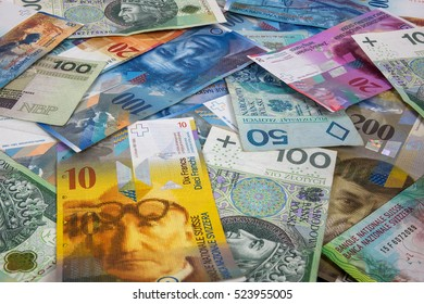 Background made of polish zloty and swiss franc banknotes