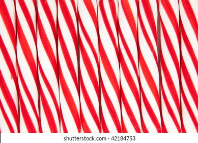 A background made of red and white striped candy canes