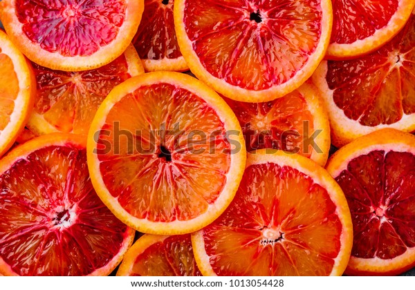 Background made of ripe juicy blood orange slices. Top view