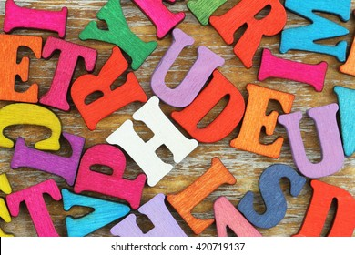 Background made of scattered colorful wooden letters