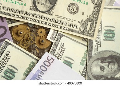 Background made from various currency banknotes and clock mechanism