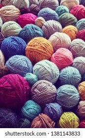 Background made of wool yarns, color toning applied, selective focus.