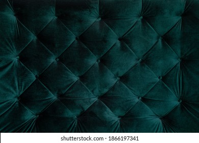 background malachite green teal velvet capitone textile, suede, velor, with buttons, sofa back. Close up photo