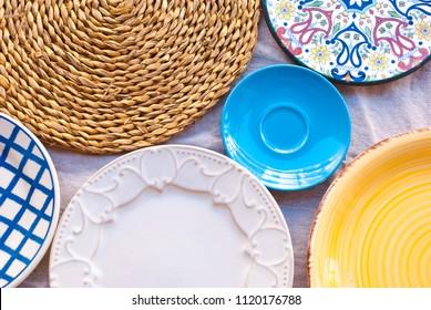 Background with many empty kitchenware. Ceramic kitchen plates.
