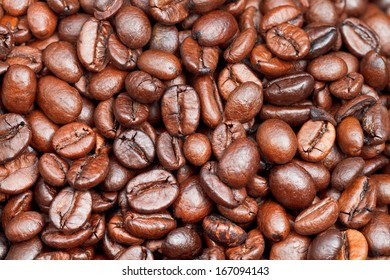 background from many light roasted coffee beans close up