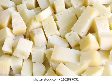 Background of many pieces of fresh cheese all cut into cubes during the buffet