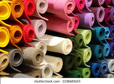 background of many rolls of colored felt at shop for hobbyists