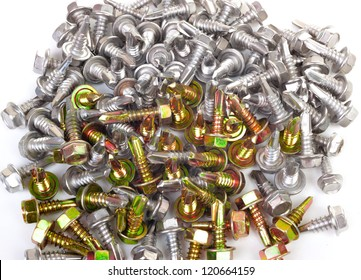 Background from many steel screws with a drill tip isolated on white background