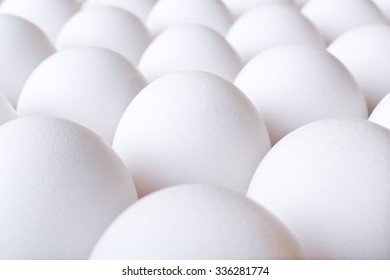 Background with many white fresh chicken eggs