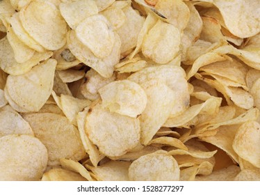 background of many yellow chips at fastfood