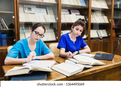 background a medical student for textbooks. The study of surgery by a two nurse in the library.