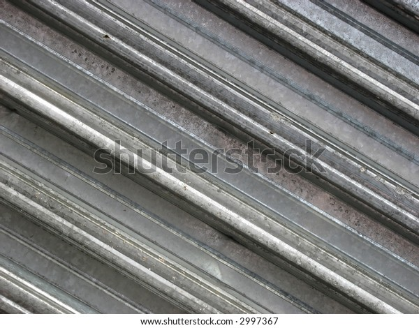 Background from metal. Diagonal lines. Construction.