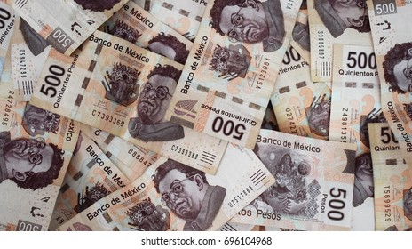 Background with Mexican money of five hundred Mexican pesos bills.