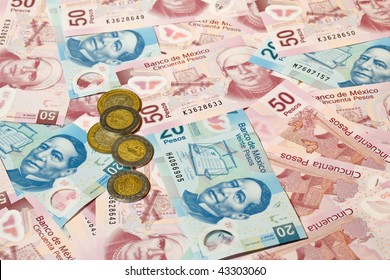 Background of Mexican pesos - 20 and 50 pesos bills and coins