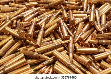Background from military machine gun cartridges. Danger concept. Highly detailed render