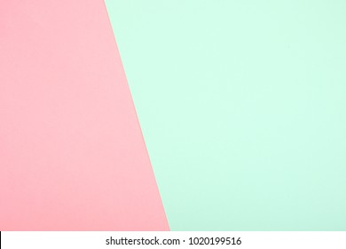 Background of mint and pink paper, pastel colors. Copy space.
