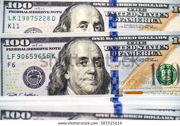 Background of a modern 100 dollar bills, large picture of the stack of hundred dollars