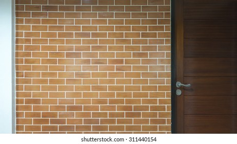 Background of modern brick wall and wooden door