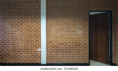 Background of modern brick wall and wooden door open
