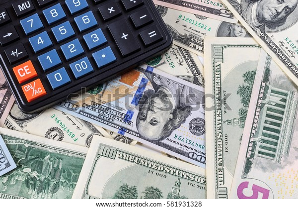 Background with money american dollar bills and black calculator. Cash money.