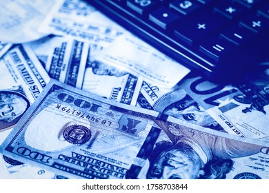 Background with money american dollar and euro bills, check and black calculator. Cash money. Black and white image.