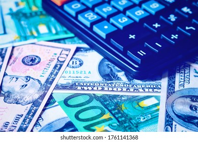 Background with money american dollar and euro bills and black calculator. Cash money.
