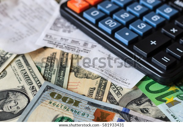 Background with money american dollar and euro bills, che and black calculator. Cash money.