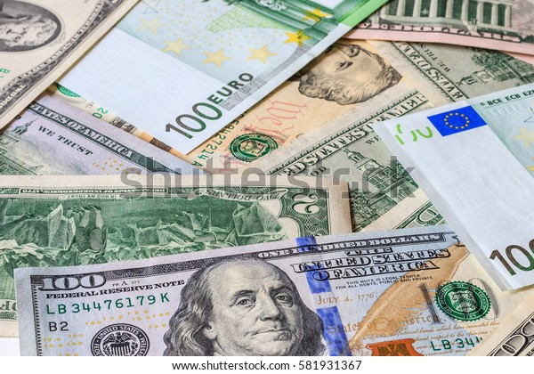 Background with money american dollar and euros bills. Cash dollars and euros.